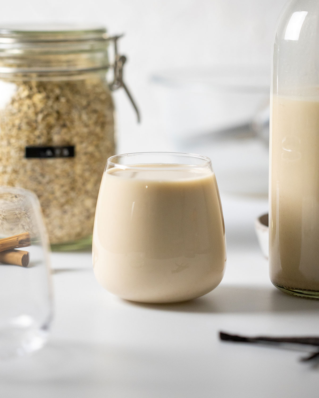 a glass full of easy homemade oat milk gluten free